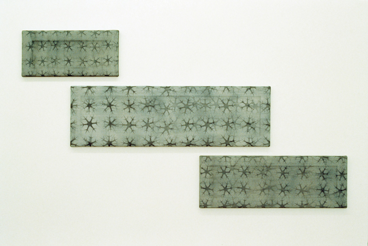 Black Ice, 1999. Enamel paint on mesh, 3 panels, 30.5 x 66 cm, 36 x 137 cm, 41 x 102 cm