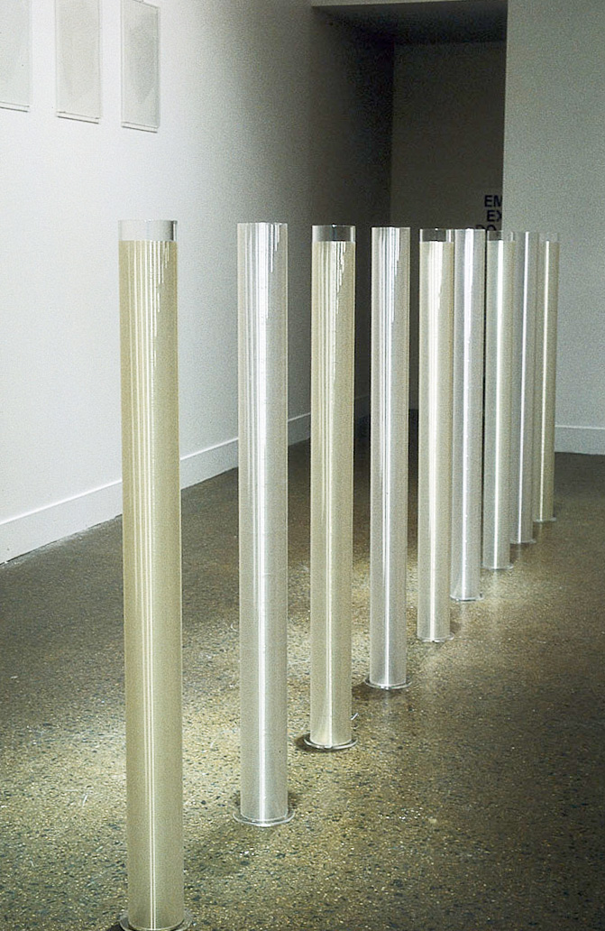 After Rain, 1992. Perspex, fishing line, 9 cylinders each 100 x 10 cm, installation view Monash University Gallery