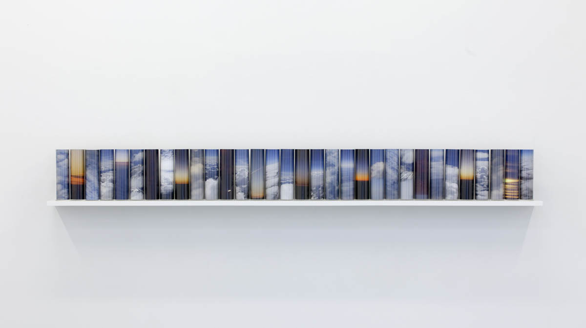 Above Sea Level #1, pigment prints on archival paper, Perspex cylinders, wooden shelf, 30 x 266 x 24cm